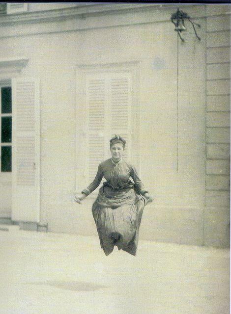 Victorian woman mid-jump
