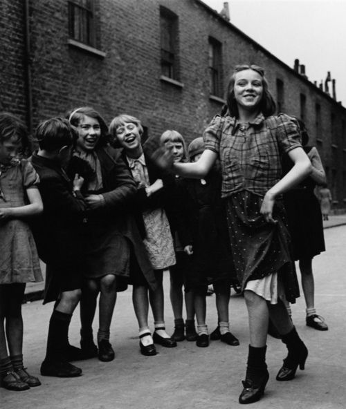 Girl doing the Lambeth Walk, popular dance craze of the late 30s