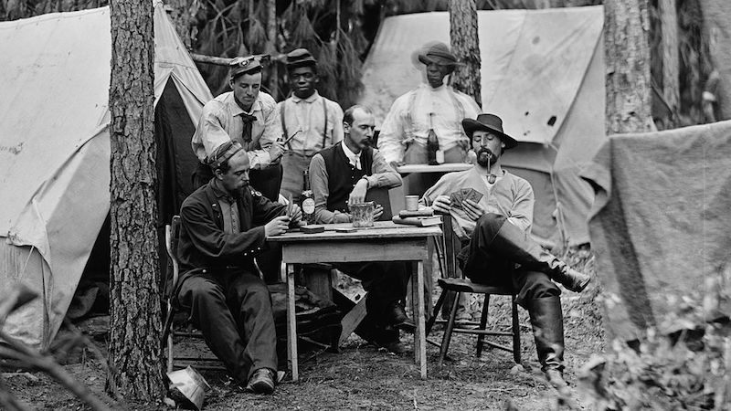 Officers of the 114th Pennsylvania Infantry playing cards in front of tents. Petersburg, Virginia, August 1864